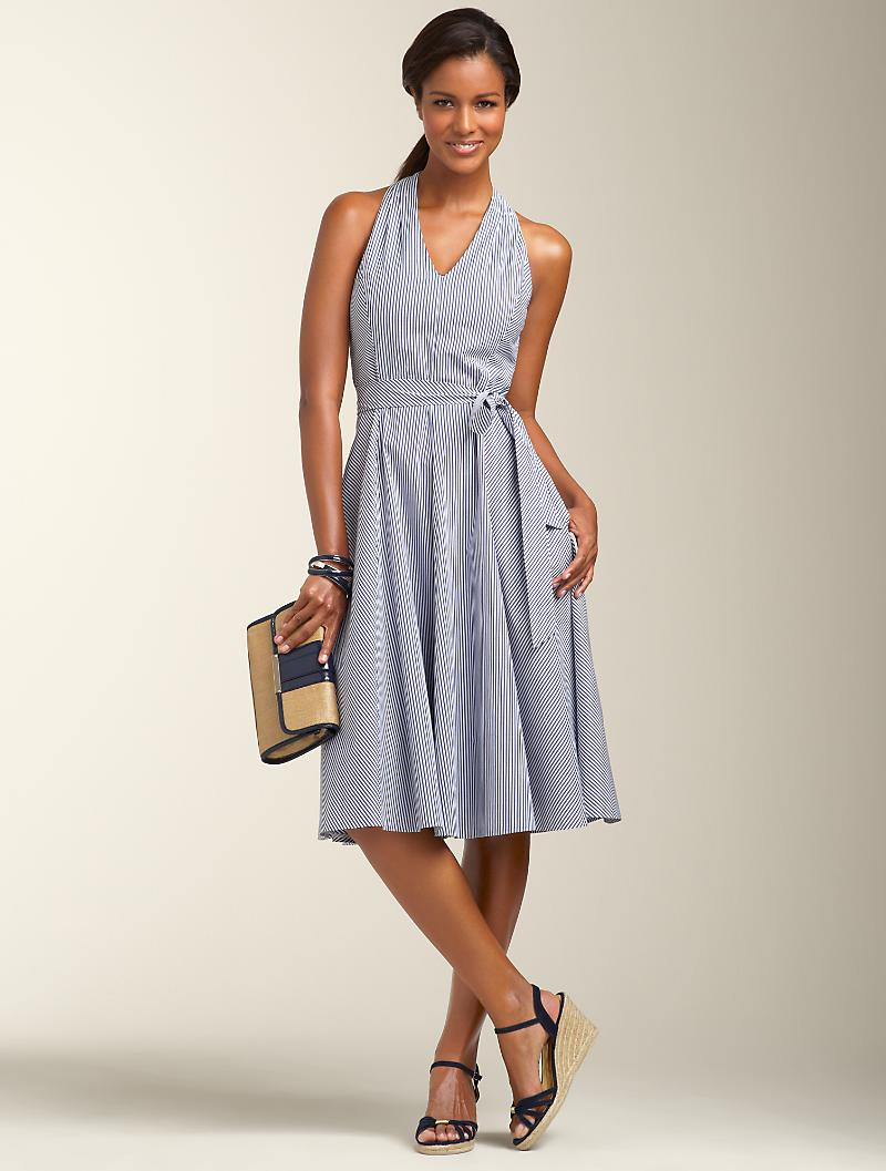 A seersucker halter dress is chic and comfortable when temperatures soar. Credit: Talbots.